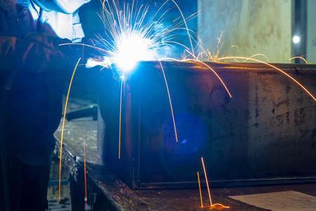 Welder performs welding work semi-automatic electric arc welding. MIG welding.