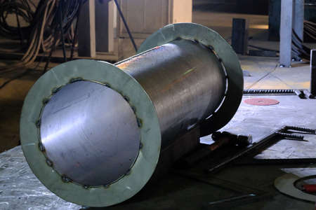 Welding stainless steel pipes using semi-automatic arc welding. MIG welding.