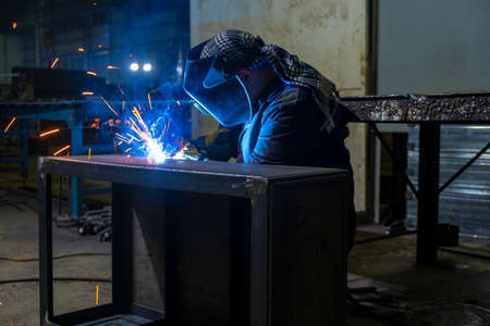 Welder performs welding work semi-automatic electric arc welding. Assembly of metal structures. MIG welding. 스톡 콘텐츠