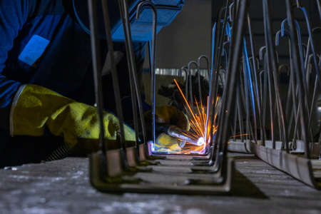 Welder performs welding work semi-automatic electric arc welding. Production of metal structures. MIG welding. 스톡 콘텐츠