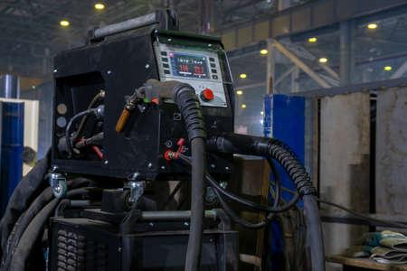 Worker performs welding of metal structures. Semi-automatic manual welding. MIG welding. Banco de Imagens