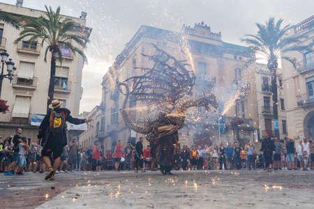 Vilanova i la Geltru, Barcelona, Spain - July 26, 2018. Encounter of dragons in Firerun (Correfoc) in the celebrations of the festival (Festa Major)