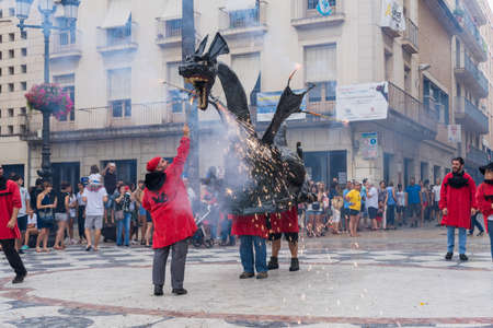 Vilanova i la Geltru, Barcelona, Spain - July 26, 2018. Encounter of dragons in Firerun (Correfoc) in the celebrations of the festival (Festa Major)
