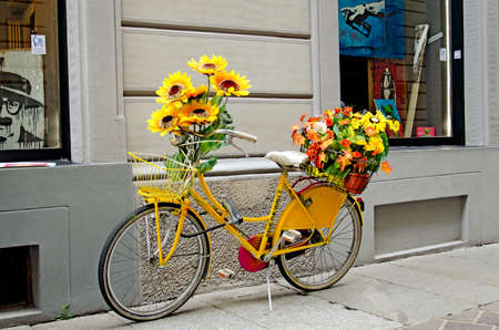 decorated bike: Yellow bicycle decorated with flow Stock Photo