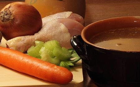 carot: chiken soup and ingredients,onion,carot,and more Stock Photo