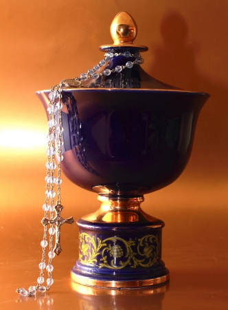 a picture a blu funeral urn with rosary
