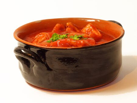 tripe cooked with tomato sauce photo