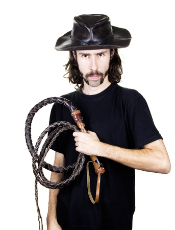 a men with whip and hat  photo