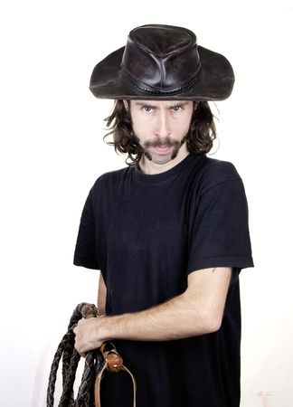 a men with whip and hat  Stock Photo - 17242072