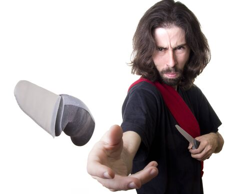 a knife thrower with long hair Stock Photo