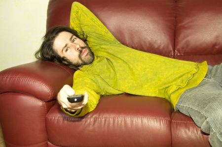 man on the couch remote control Stock Photo