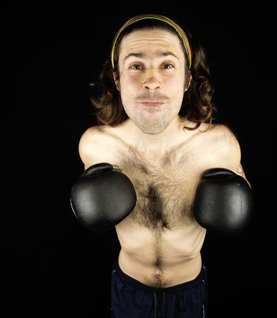 a small thin man that makes boxing Stock Photo - 17603674