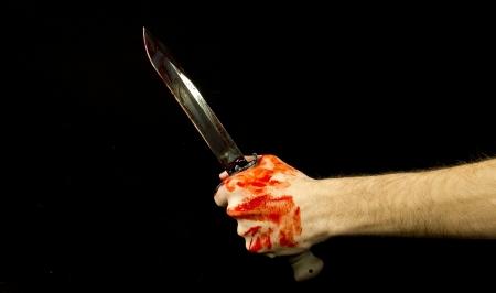 cuchillo de cocina: cuchillo y la mano Foto de archivo