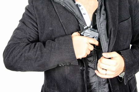 gun in the jacket Stock Photo - 19424305
