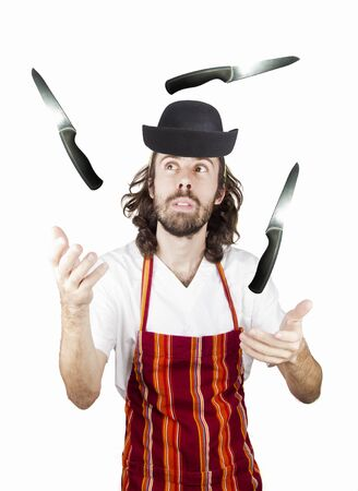a chef play with the knife Stock Photo