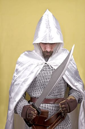 assassin: a white medioeval assassin in the yellow background