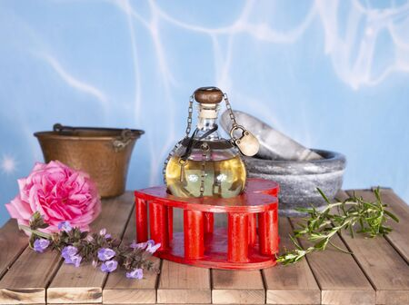 love potion in the wood background and flower,ingredients e varius