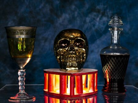 voodoo ritual with skull and magic potion in the glass glowing