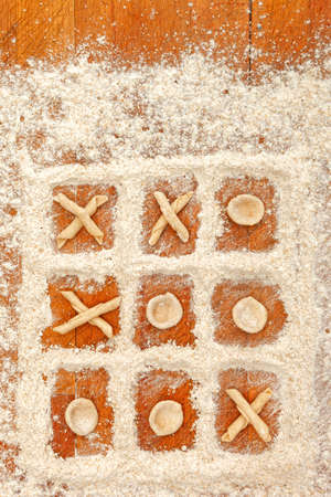 maccheroni: Tic tac toe with flour and fresh handmade italian pasta orecchiette and maccheroni