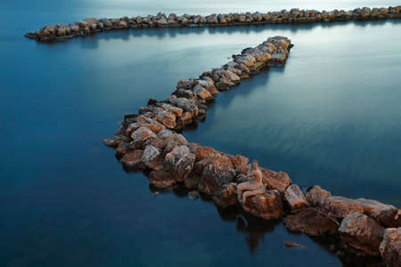 breakwaters: Breakwaters with stone mermaid, Taranto, Italy