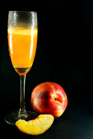 bellini: Bellini drink with peach on black background