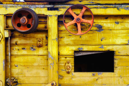 in particular: Particular of yellow vintage rail wagon