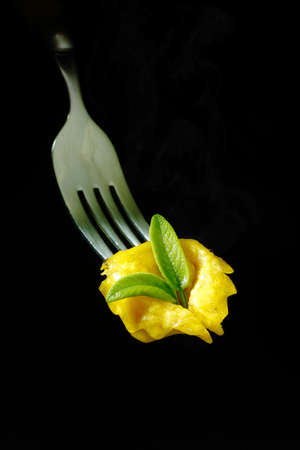 fresh pasta: Italian fresh pasta tortellini with butter and sage on fork Stock Photo