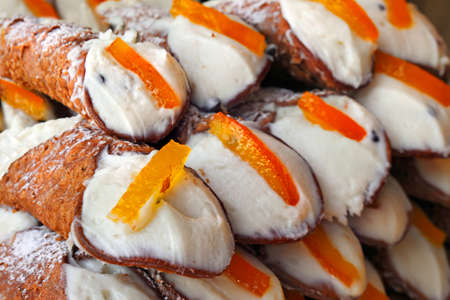gluttonous: Sicilian sweets cannoli with ricotta cheese and candied orange Stock Photo