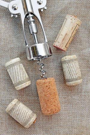 cork   screw: Wine corks and steel cork screw on texture Stock Photo