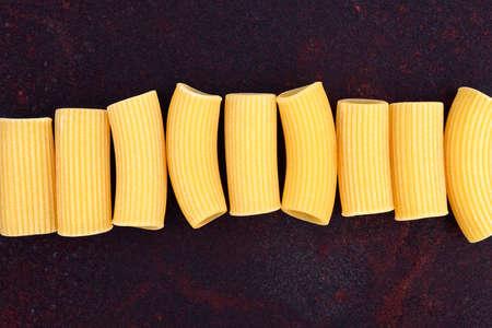 maccheroni: Maccheroni raw pasta on rusty background