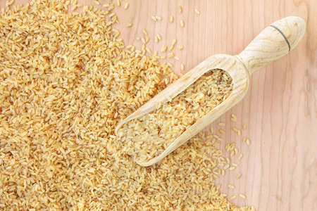 bailer: Bailer of whole rice on a wooden table