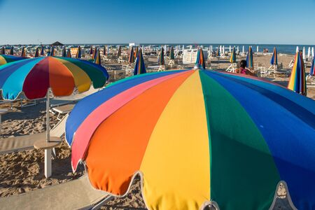 idling: The Colorful umbrella on the beach Stock Photo