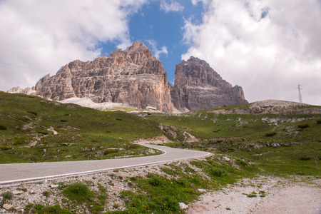 literally: The Tre Cime di Lavaredo Italian for the three peaks of Lavaredo, also called the Drei Zinnen German, literally three merlons, are three distinctive battlement-like peaks, in the Sexten Dolomites of northeastern Italy. They are probably one of the bes Stock Photo