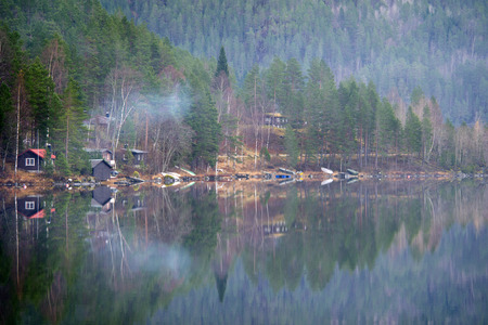 kilometres: Norway has a total area of 385,252 square kilometres, has an extensive coastline, facing the North Atlantic Ocean and the Barents Sea.
