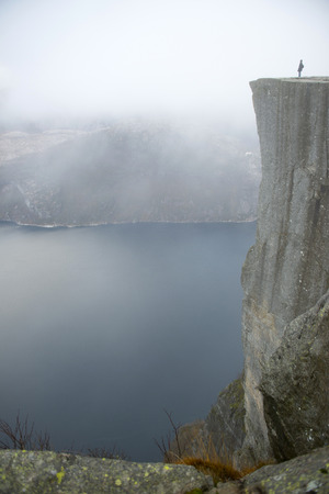 english famous: Preikestolen or Prekestolen, also known by the English translations of Preachers Pulpit or Pulpit Rock, is a famous tourist attraction in Forsand, Ryfylke, Norway. It consists of a steep cliff which rises 604 metres 1982 feet above Lysefjorden, opposite