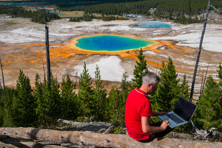 prismatic: Business man at work in Grand Prismatic Spring, Yellowstone National Park, Wyoming
