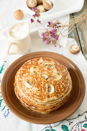 rubicund: Stack of pancakes with sour cream and mushrooms