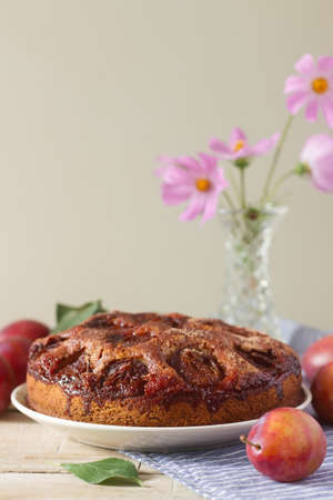 Plum pie or cake with cinnamon and sugar. Plum cake from the newspaper New York Times . Selective focus.