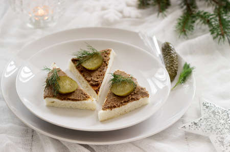 Canape with pate, canned cucumber and dill. Snack. Selective focus.