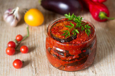 Appetizer from eggplants with paprika and tomato sauce. Rustic style, selective focus.