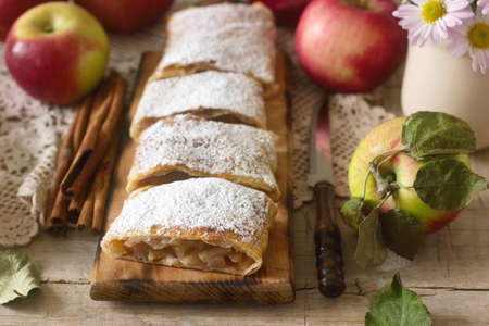 Homemade strudel with apples. Rustic style, selective focus