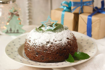 Christmas cake or pudding in festive decoration. Selective focus. Stock Photo