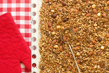 Homemade granola on a baking sheet in festive decoration. Rustic style, selective focus. Stok Fotoğraf