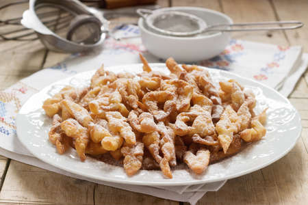 Angel wings biscuits, a traditional European sweet dish for carnival. Rustic style, selective focus. 스톡 콘텐츠