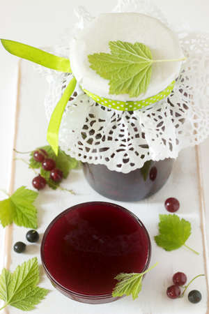 Jam or marmalade of black and red currant and currant berries on a light background.