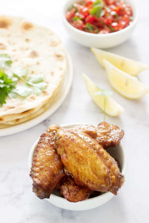 Homemade delicious food of tortillas, salsa and fried wings. Stok Fotoğraf - 124901534