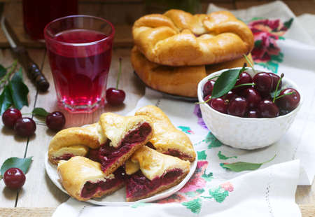 Traditional homemade Romanian and Moldovan pies - Placinta, served with wine. Rustic style.
