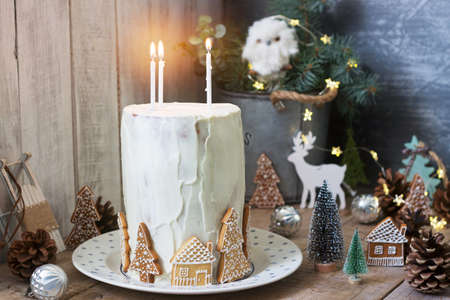 Homemade honey cake with sour cream, decorated with gingerbread. Rustic style, festive decoration.