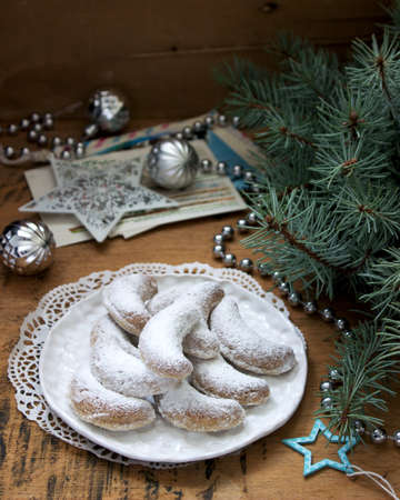 Vanilkipferl - vanilla crescents, traditional Christmas cookies in Germany, Austria, Czech Republic. Homemade cookies in Christmas or New Year's decor. Selective focus.