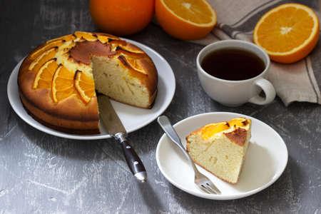 Orange cake with slices of orange on a concrete background. Zdjęcie Seryjne